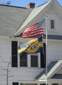 A Green Bay Packer flag flies upside-down on a late February afternoon in La Crosse.