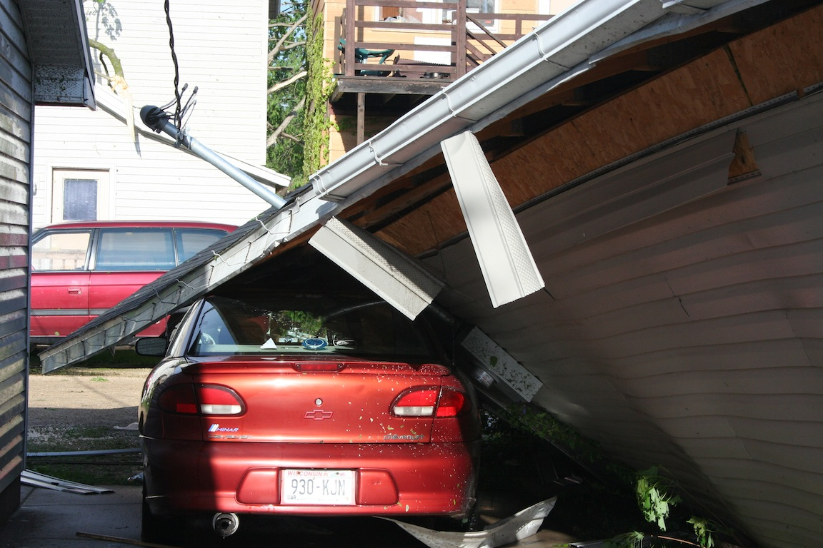 Car under Garage - 1100 block Green Bay St.
