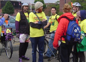 Obbie, Red, and many other cyclists at an event to greet riders of solar powered bikes.