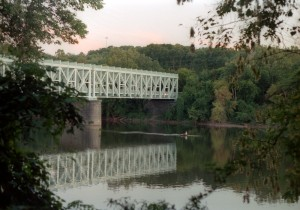 The Falls Bridge crosses the Schuylkill River in Fairmount Park, Philadelphia.
