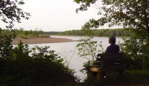 Obbie takes in the Chippewa River at a resting stop between Eau Claire and Durand, celebrating the fact that a nuclear power plant was not built there.